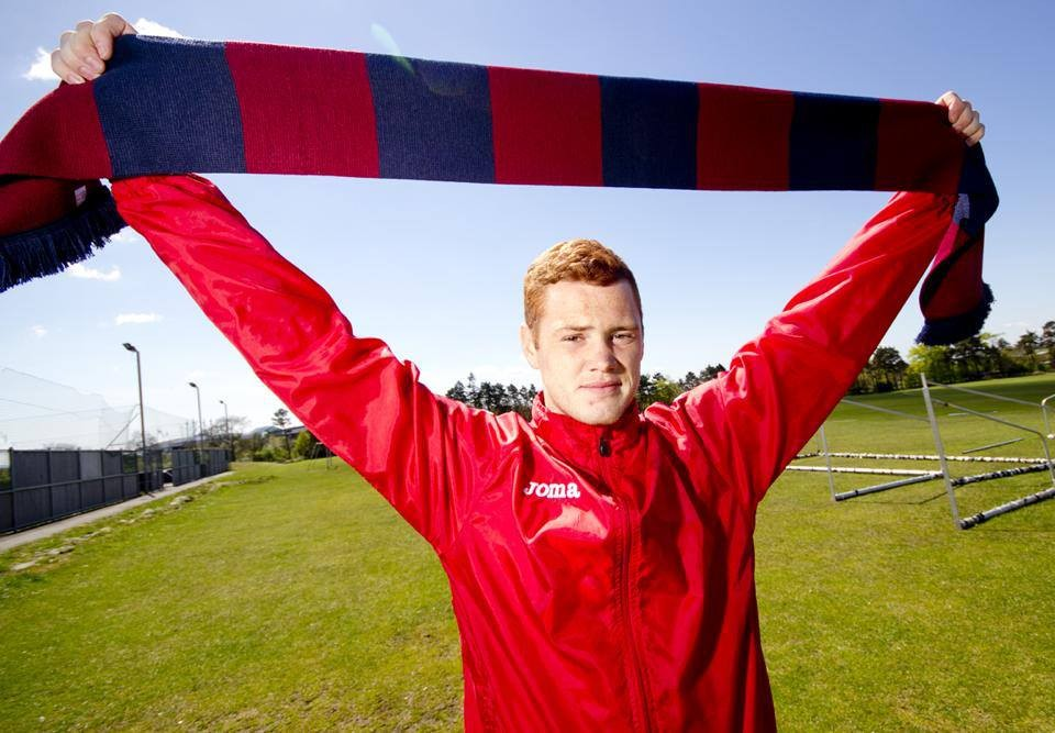 Ryan Thomson with Into the Valley collector`s edition scarf